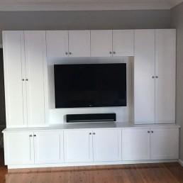 custom tv unit with lots of storage around tv