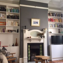 custom open bookshelves on either side of fire place