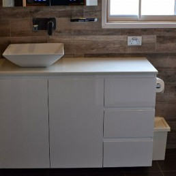 Custom vanity by sublime kitchens and bathrooms with wood look tiles